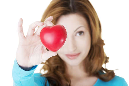 Attractive smiling woman showing red heart toy Stock Photo - 20108559