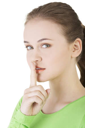 Hush be quiet woman isolated. Teen girl with finger on her lips.  photo