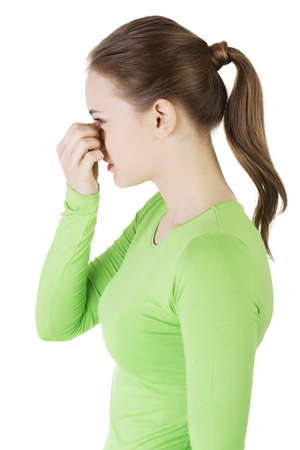 Young woman with sinus pressure pain , isolated. photo