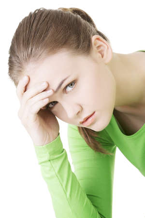 Young sad woman, have big problem or depression, over white background Stock Photo - 20108362