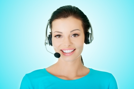 Beautiful young call-center assistant smiling 版權商用圖片