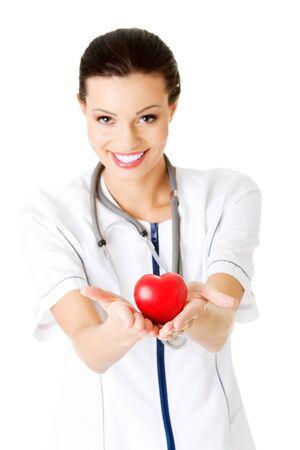 Giovane infermiera con il cuore in mano, isolato su bianco. Archivio Fotografico - 22461354