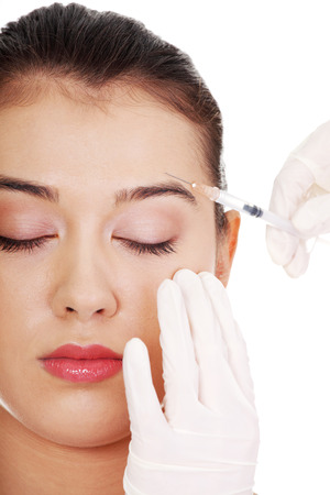 Cosmetic botox injection in the female face, eye and eyebrow zone 版權商用圖片 - 22468527