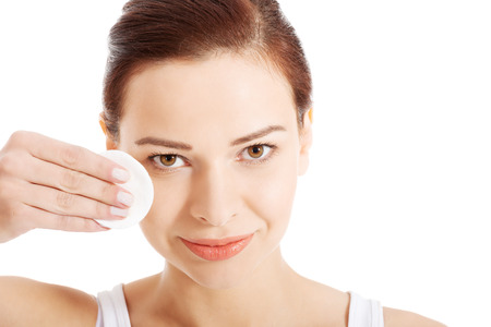 beautiful woman cleaning her face with cotton pads  Isolated on white 版權商用圖片 - 24522175