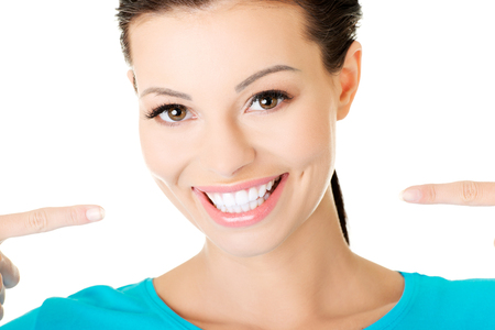 beautiful casual woman showing her perfect white teeth  Isolated on white