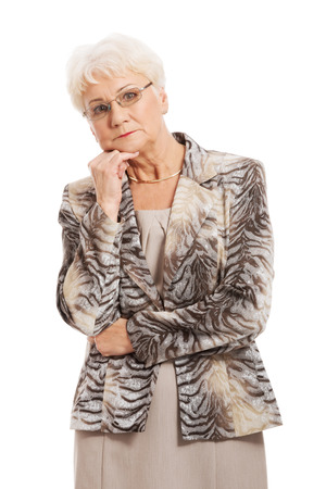An old elegant lady having her hand under chin  Isolated on white  Reklamní fotografie