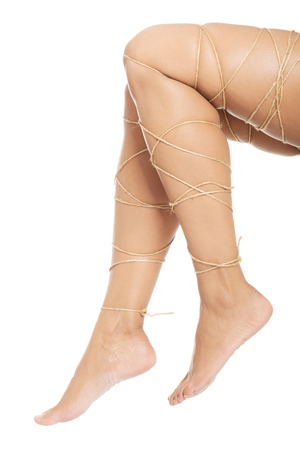 Legs pain concept - legs tied with rope isolated 版權商用圖片