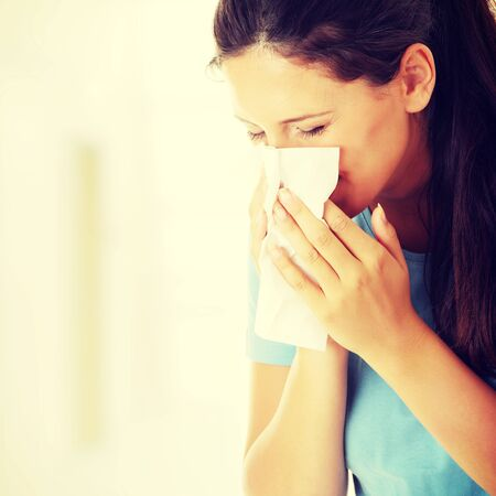 Teen woman with allergy or cold 写真素材