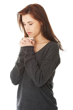 Junge betende Frau mit den Händen zusammen Standard-Bild - 28761737