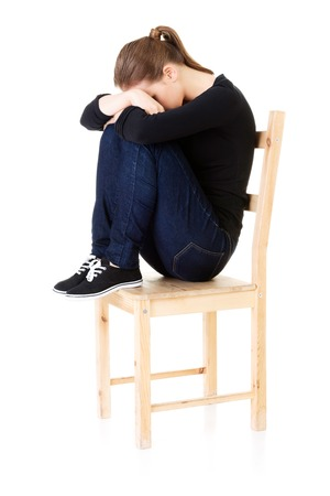 Sad teen girl heaving depression. 版權商用圖片