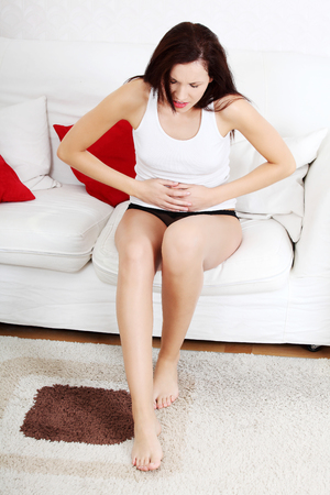 A photo of woman with stomach ache. Illness concepion. photo