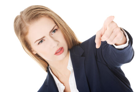 Beautiful business woman is showing warning sign  Over white  Stock Photo