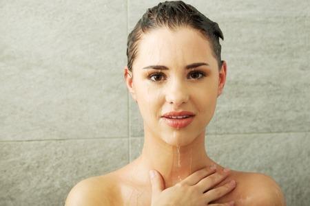 Beautiful  fit woman taking shower