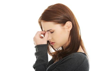 副鼻腔圧痛を持つ若い女 写真素材