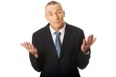 Portrait of businessman making undecided gesture.