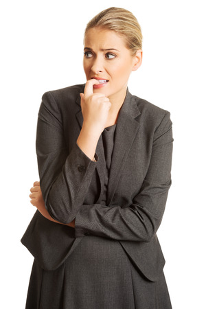 Stressed businesswoman biting her nails. Banque d'images