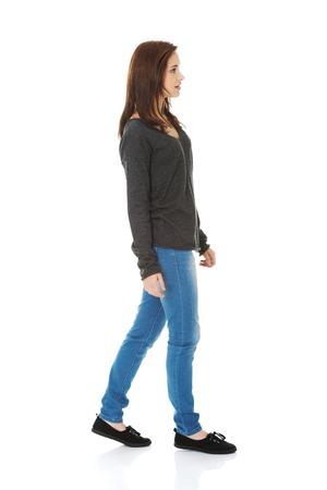 Young beautiful woman walking smiling