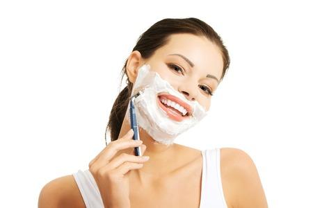Portrait of happy woman shaving beard.