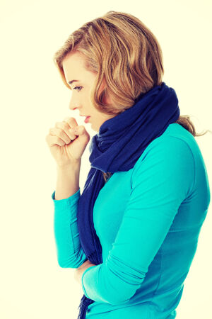 Young woman has a flu. Coughing. Stock Photo