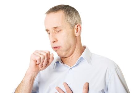 Mature man coughing because of flu.
