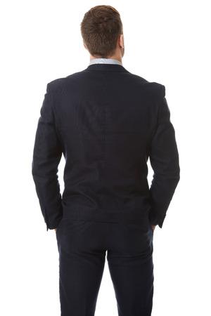 Knappe zakenman die zich terug naar de camera.