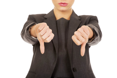 Modern business woman showing thumbs down.