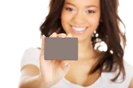 Happy african woman holding a card. Stock Photo - 38655392