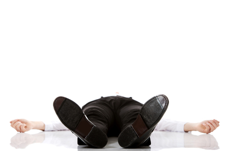 Young exhausted businessman lying on the floor. Stock Photo