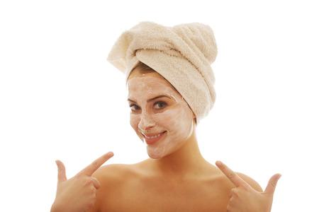 Portrait of a woman with cream lotion showing her face Foto de archivo