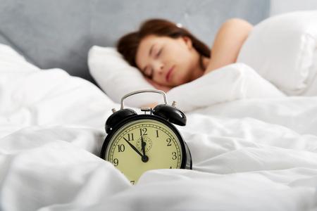Beautiful woman sleeping in bed. 版權商用圖片