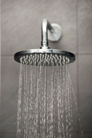 Shower head with water stream.