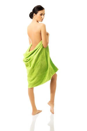 Woman wrapped in towel back to the camera.