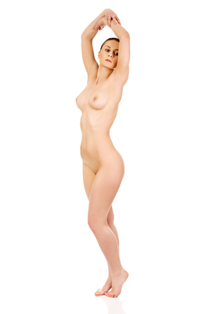 Active nude woman stretching arms.