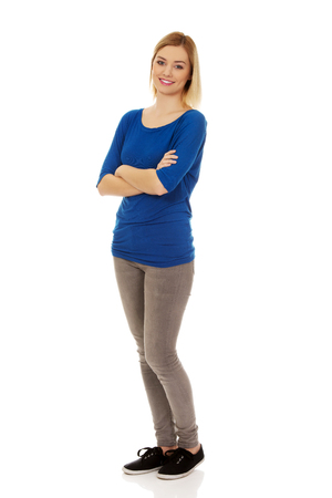 Casual woman with arms crossed smiling.