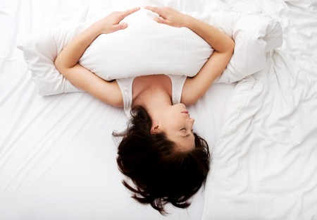 Beautiful woman sleeping in bed. Stock Photo