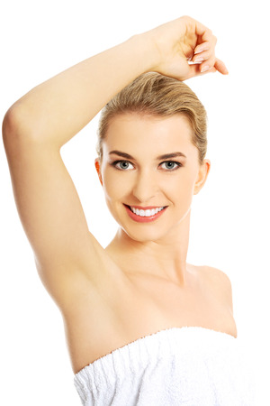 Beautiful happy spa woman showing her shaved armpit. Reklamní fotografie - 42216030