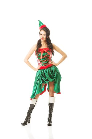 Full length woman wearing elf clothes, touching her hips.