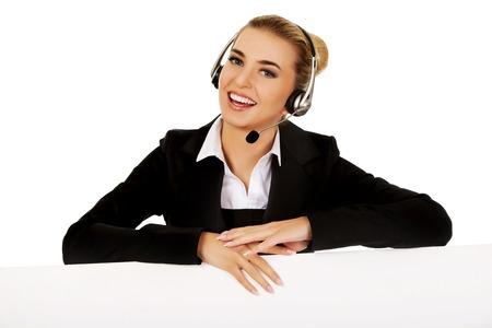 Smile call center woman holding empty banner Stok Fotoğraf - 46225346