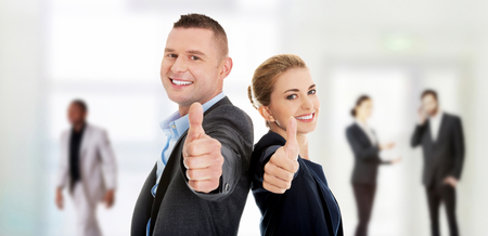 Happy business couple showing thumbs up. Reklamní fotografie - 50117769