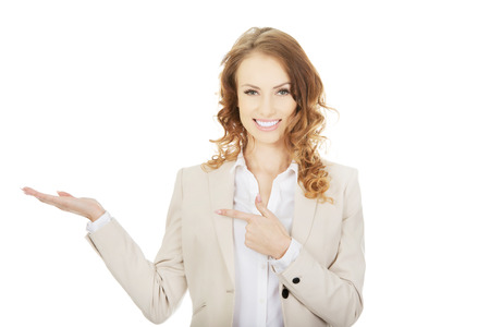 Business woman pointing on her hand.