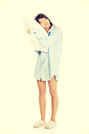 Young morning woman in big shirt and pillow. 写真素材