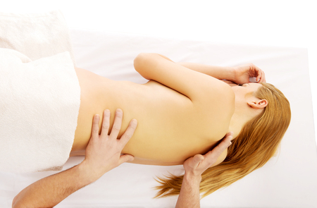 Pregnant woman having a massage on her back Stock Photo