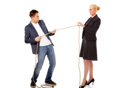 Boss concept-woman holding rope in two fingers, man pulling a rope and can't win.