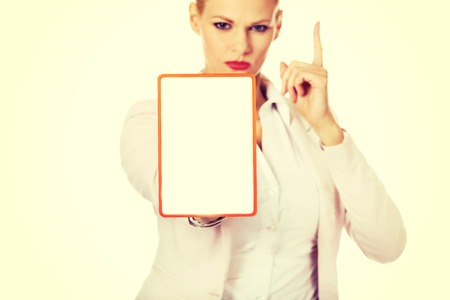 Young business woman holding a board with ban.