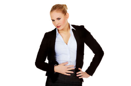 Business woman with stomach ache.