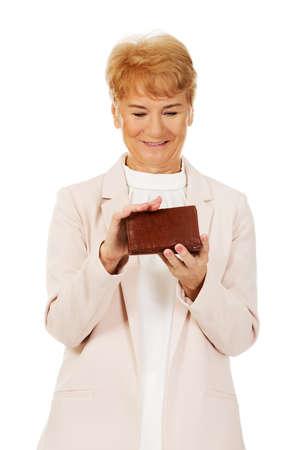 Smile senior woman holding wallet.