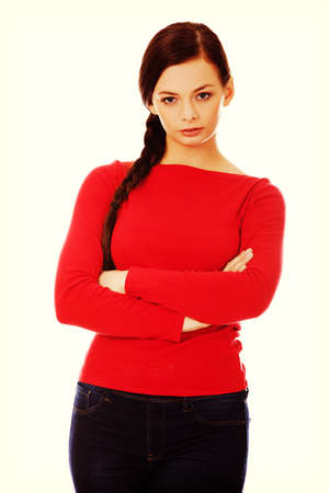 Annoyed young woman with arms crossed Stock Photo