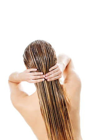 Photo of woman applying hair egg conditioner