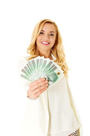 Beautiful casual woman holding money. Reklamní fotografie