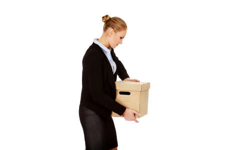Sad business woman carrying box after loosing job 版權商用圖片